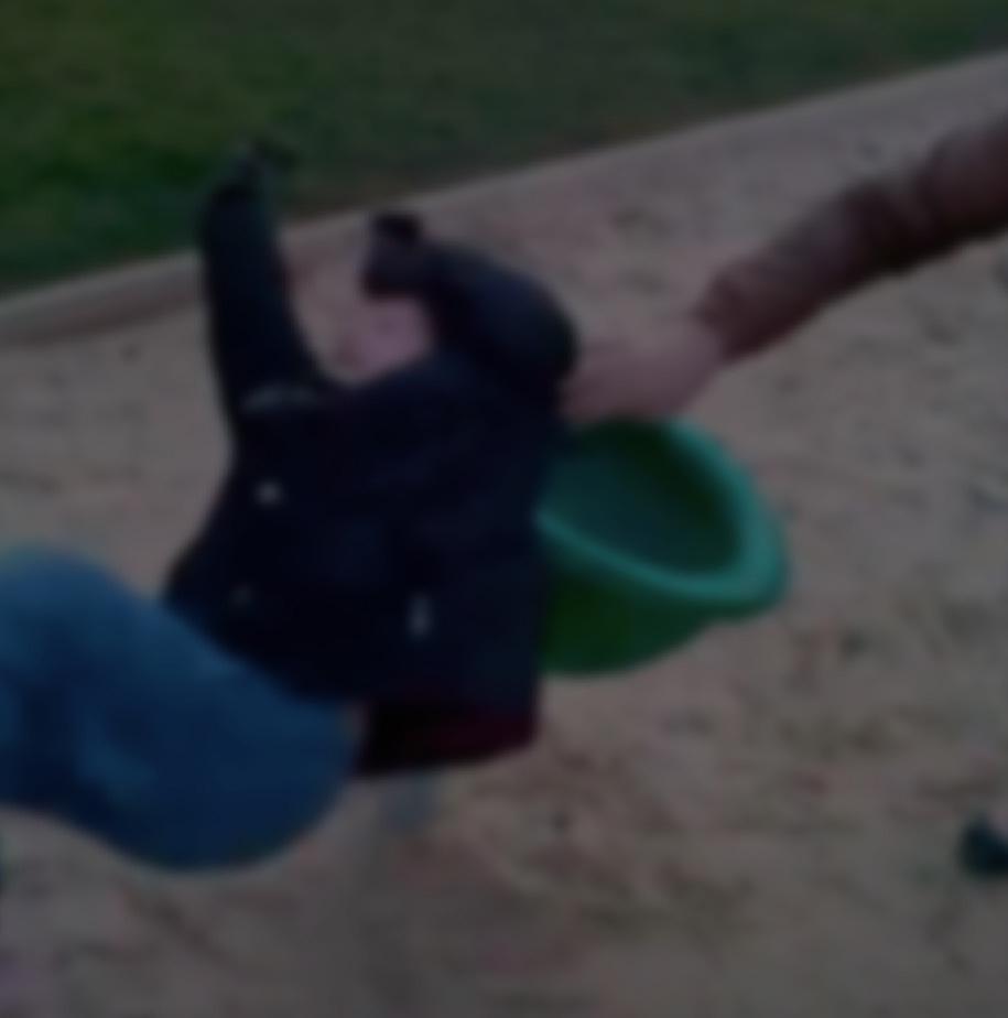 Child spinning off of playground ride