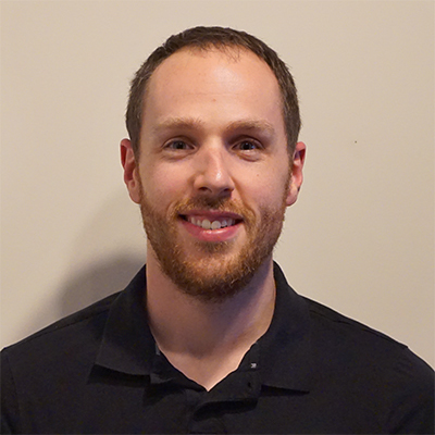 Headshot of Greg Jensen