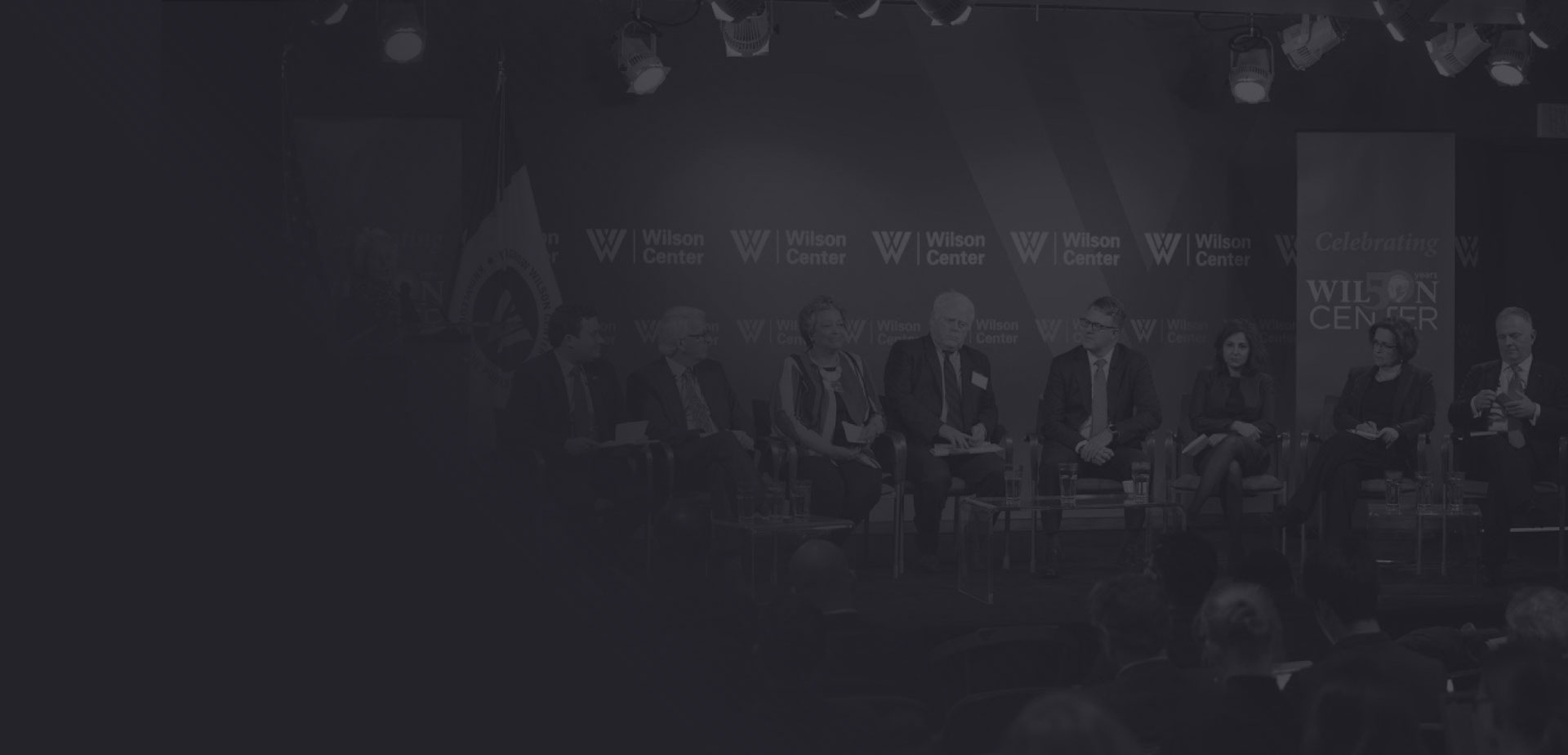 Speakers having a public discourse on stage during an event